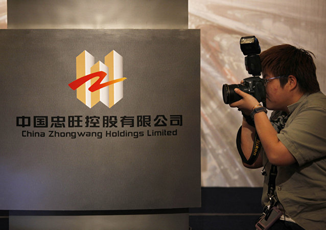 A photographer takes a picture of the logo of China Zhongwang Holdings Limited displayed at a news conference in Hong Kong (File)