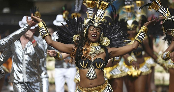 Performers participate in the parade at the Notting Hill Carnival in London Britain