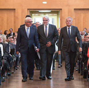 German Foreign Minister Frank-Walter Steinmeier (L) and his counterparts from France, Jean-Marc Ayrault (R) and from Poland, Witold Waszczykowski (C), arrive to attend the Ambassadors Conference at the Federal Foreign Office in Berlin on August 29, 2016