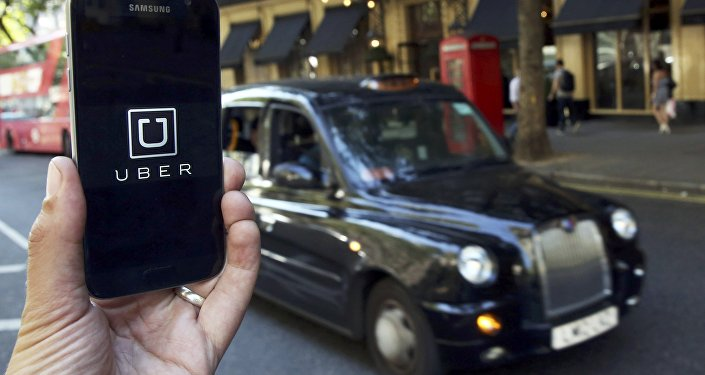 A photo illustration shows the Uber app logo displayed on a mobile telephone, as it is held up for a posed photograph in central London, Britain August 17, 2016.