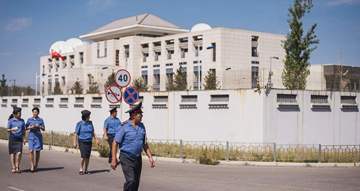 Bishkek, Kyrgyzstan. Law enforcement officers near the Chinese Embassy whose gate was rammed by a Mitsubishi Delica car loaded with explosives