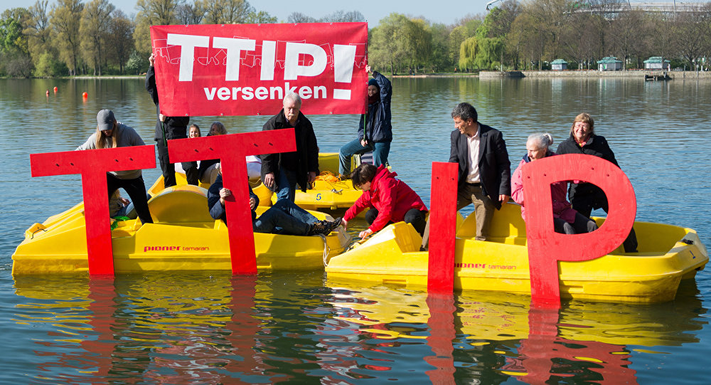 Anti- Trans-Atlantic Trade and Investment Partnership (TTIP)activists sink the lettering TTIP in the Maschsee in Hanover on April 21, 2016 ahead a meeting of leaders of Britain, France, Germany and Italy on April 25, 2016