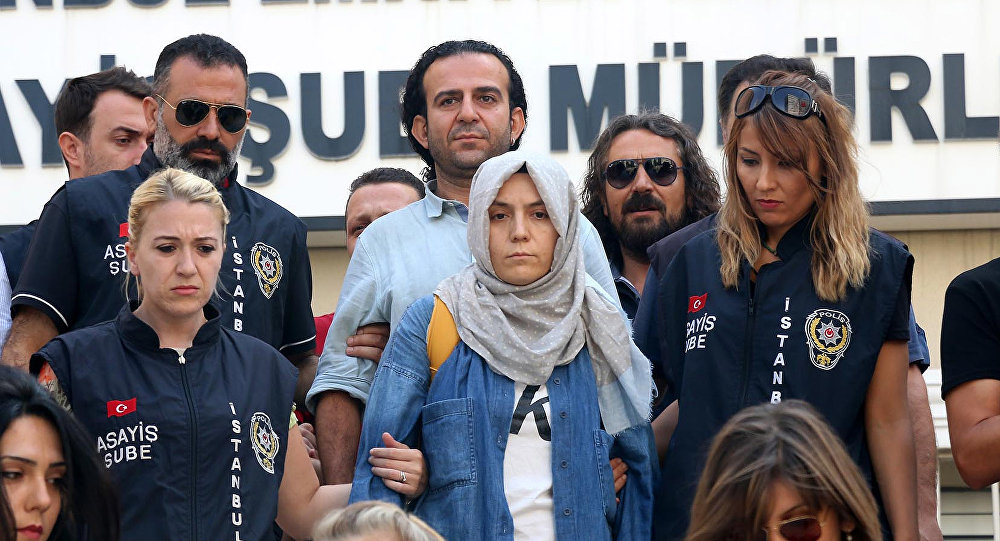 Police escort journalists to court, in Istanbul, Friday, July 29, 2016