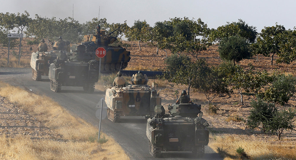 Turkish armoured personnel carriers drive towards the border in Karkamis on the Turkish-Syrian border in the southeastern Gaziantep province, Turkey, August 27, 2016