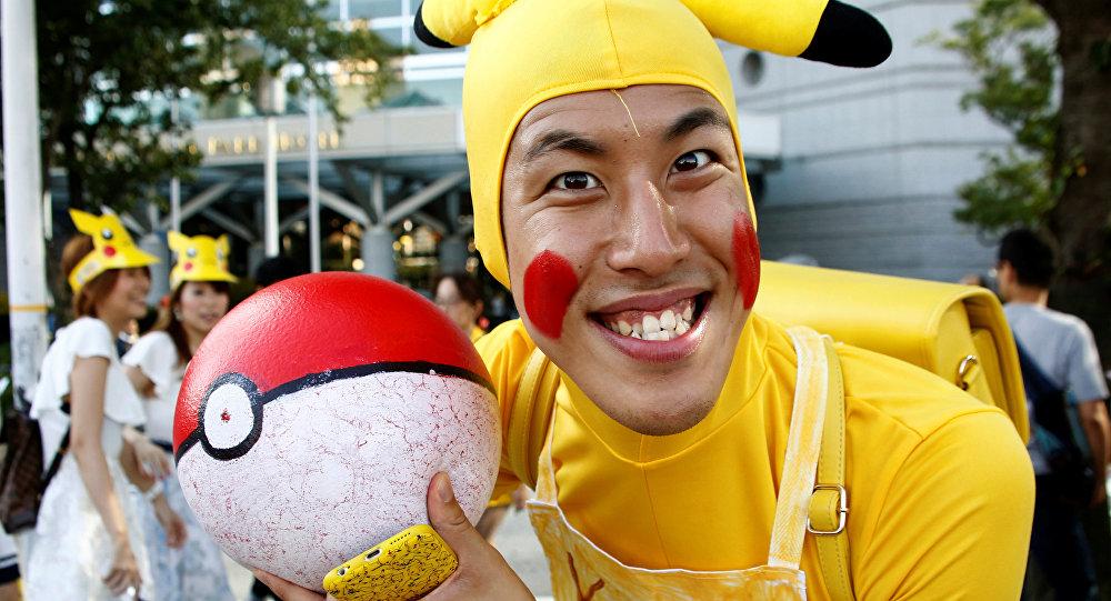 A man wearing Pokemon's character Pikachu costume