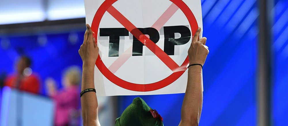 A delegate hoists and anti-TPP sign on Day 1 of the Democratic National Convention at the Wells Fargo Center in Philadelphia, Pennsylvania, July 25, 2016