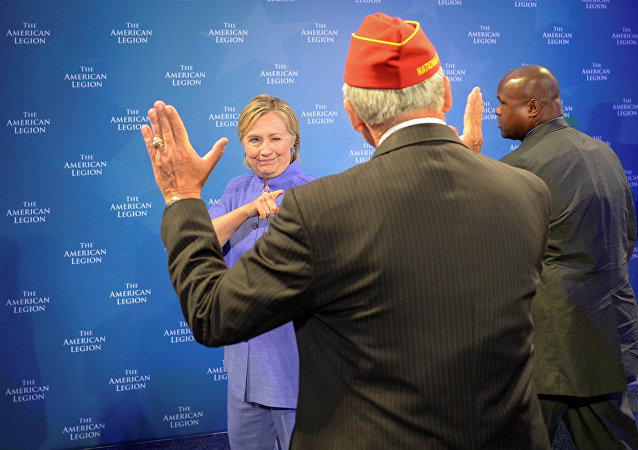 Democratic presidential nominee Hillary Clinton winks at the National Commander of the American Legion Dale Barnett after she addressed the National Convention in Cincinnati, Ohio, U.S., August 31, 2016