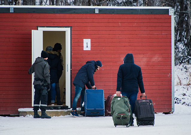 Refugees are welcomed upon arrival at the Norwegian border crossing station at Storskog after crossing the border from Russia near Kirkenes.