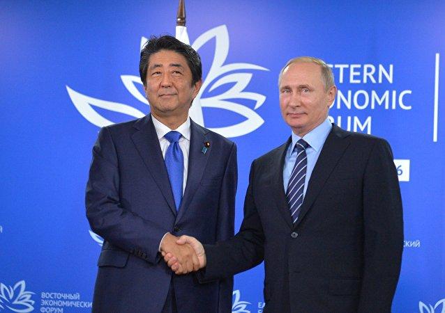 Japanese Prime Minister's Shinzo Abe  and Russian President Vladimir Putin