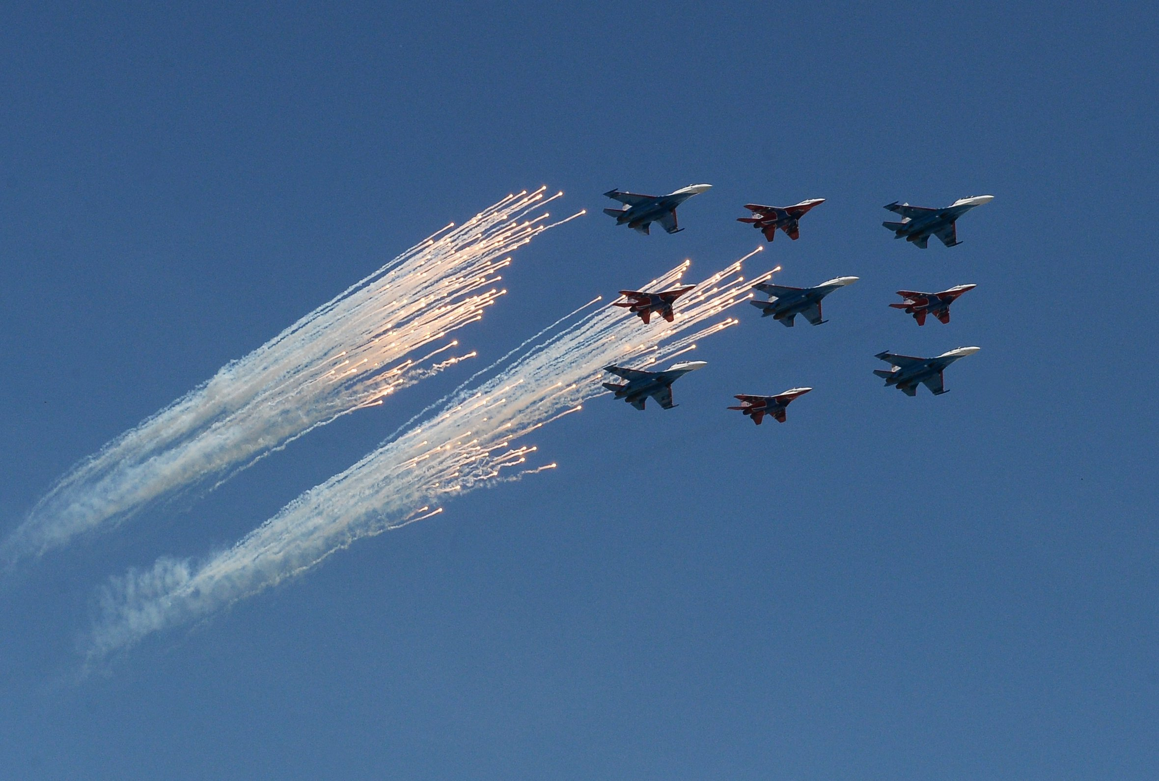 Sukhoi Su-27 Flanker fighters of the Russian Knights aerobatic team and Mikoyan-Gurevich MiG-29 Fulcrum fighters of the Swifts aerobatic team at the military parade to mark the 71st anniversary of Victory in the 1941-1945 Great Patriotic War