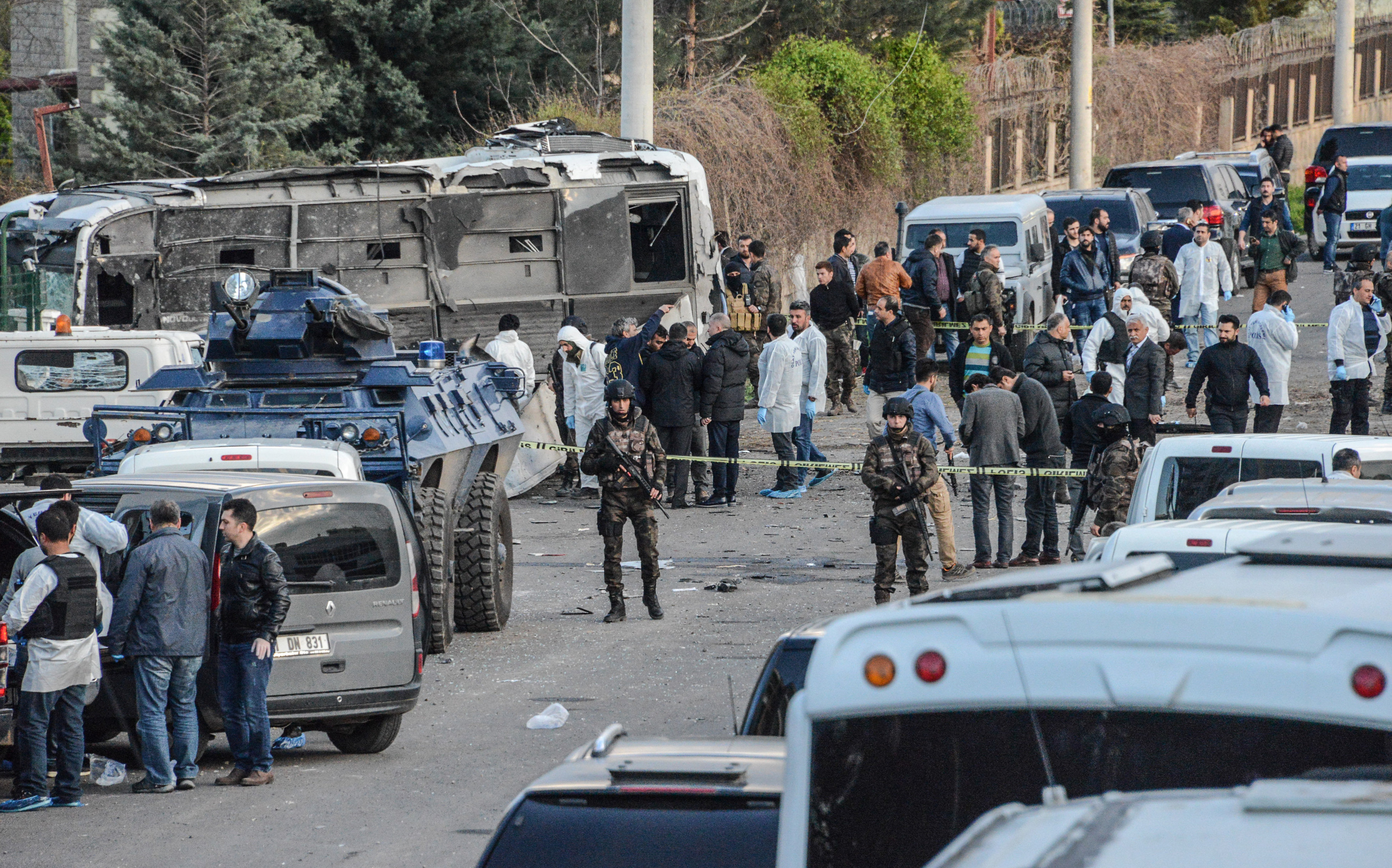 Turkish special force police officers walk at the site of a bomb attack in Diyarbakir, southeastern Turkey, on March 31, 2016