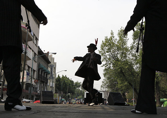 Men dressed in 1940s-era zoot suits dance during a festival in honor of Tin Tan in Mexico City. (File)