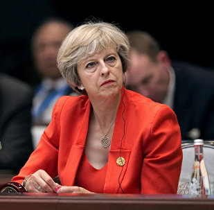 Britain's Prime Minister Theresa May listens to the speech of China's President Xi Jinping during the opening ceremony of the G20 Summit in Hangzhou, China, September 4, 2016.