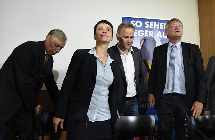 (L to R)Chair of Alternative for Germany (AFD) in Lower Saxony Armin Paul Hampel,leader of the AFD Frauke Petry, top candidate for the AFD in Mecklenburg-Western Vorpommern Leif-Erik Holm and co-leader of AFD Joerg Meuthen arrive for a press conference in Berlin, on September 5, 2016.