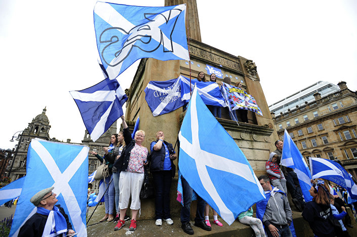 Pro Independence supporters waves the Scottish flag during a rally in George Square in Glasgow, Scotland, on September 19, 2015.