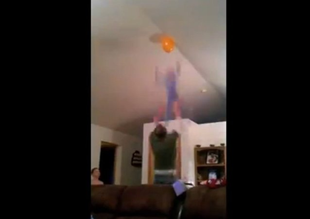 Dad Throws Son to Grab Balloon on Ceiling