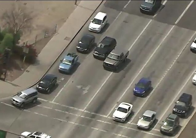 Police Chase in Phoenix, Arizona, captured by FOX 10 channel, that resulted in deadly shooting