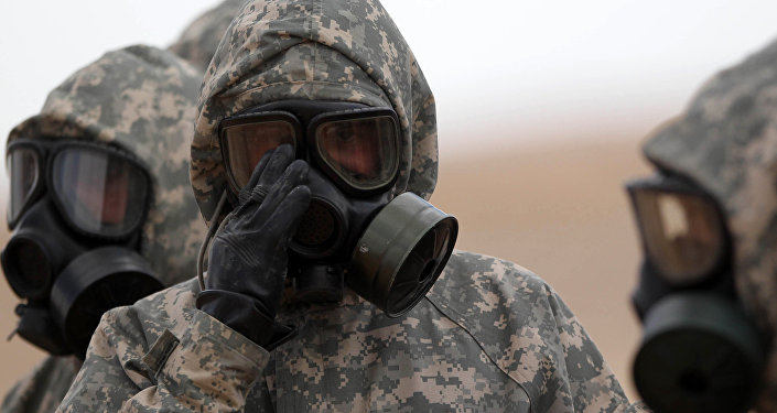 Soldiers wear mask sas they take part in a military exercise simulating a chemical weapons attack during the international Eager Lion military event on June 2, 2014 at Prince Hashem Bin Abdullah II training center, in Zarqa, 30 km east of Amman, Jordan