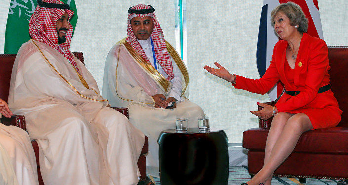 Britain's Prime Minister Theresa May (R) and Saudi Arabia's Deputy Crown Prince Mohammed bin Salman (L) meet ahead of G20 Summit in Hangzhou, Zhejiang province, China, September 4, 2016.