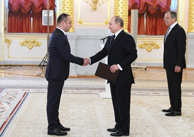 Russian President Vladimir Putin, right, and Ambassador of South Ossetia to Russia Znaur Gassiyev, left, at a ceremony to receive credentials from ambassadors of 15 countries in the Grand Kremlin Palace's Alexander Hall, November 26, 2015
