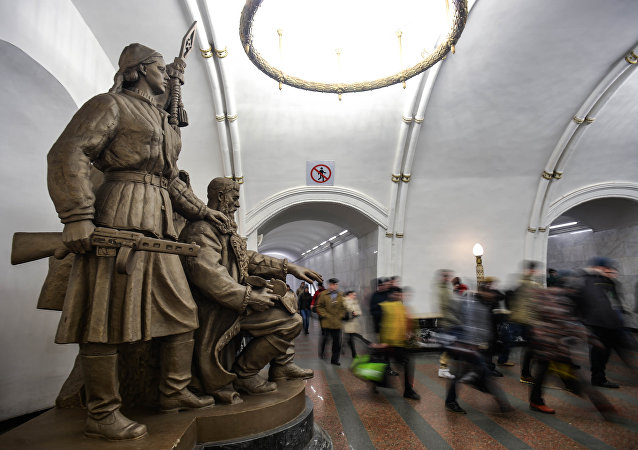 Sculpture Belarusian Partisans installed inside the passage at Belorusskaya station of the Moscow metro