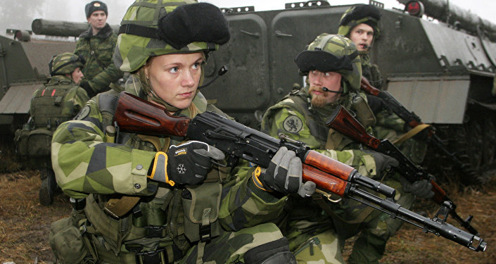 A female Swedish soldier participates in joint Russian-Swedish military training exercises, 12 December 2007, outside St. Petersburg in the town Kamenka
