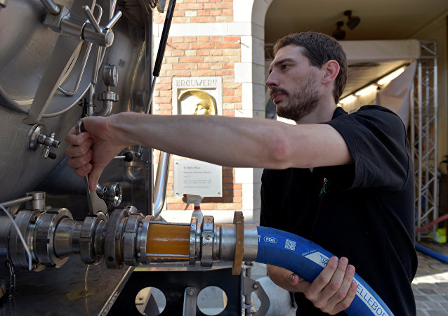 An employee of De Halve Maan brewery connects a pipe to feed beer into a truck in Bruges, September 15, 2016