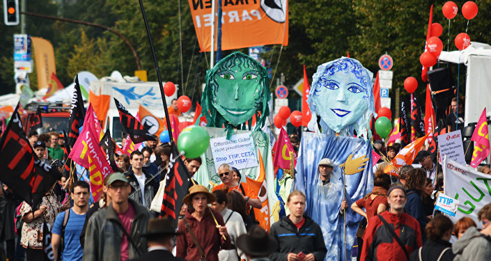 Rights activists take part in a march to protest against the Transatlantic Trade and Investment Partnership (TTIP) and Comprehensive Economic and Trade Agreement (CETA) in Berlin, Germany