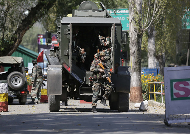 Indian army soldiers arrive at the army base which was attacked by suspected rebels in the town of Uri, west of Srinagar, Indian controlled Kashmir, Sunday, Sept. 18, 2016.