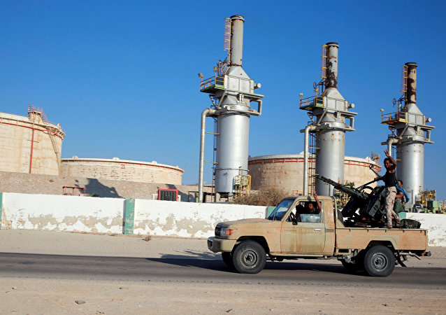Libyan forces loyal to eastern commander Khalifa Haftar ride a pickup truck at the Zueitina oil terminal in Zueitina, west of Benghazi, Libya. file photo