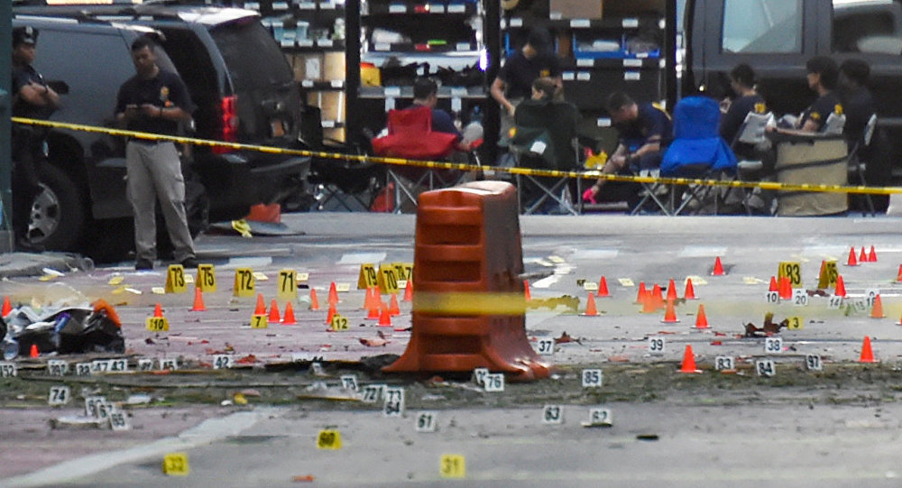 Evidence markers on the street surround police and Federal Bureau of Investigation (FBI) officials near the site of an explosion in the Chelsea neighborhood of Manhattan, New York, U.S. September 18, 2016.