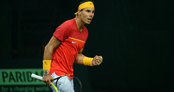 Spain's Rafael Nadal celebrates a point during his doubles tennis match with teammate Feliciano Lopez against India's Leander Peas and Saketh Myneni at the Davis Cup World Group tennis playoffs between Spain and India in New Delhi