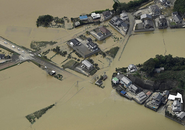 An aerial view shows flooded area due to heavy rains caused by Typhoon Malakas in Nobeoka, Miyazaki Prefecture, southwestern Japan, in this photo taken by Kyodo September 20, 2016