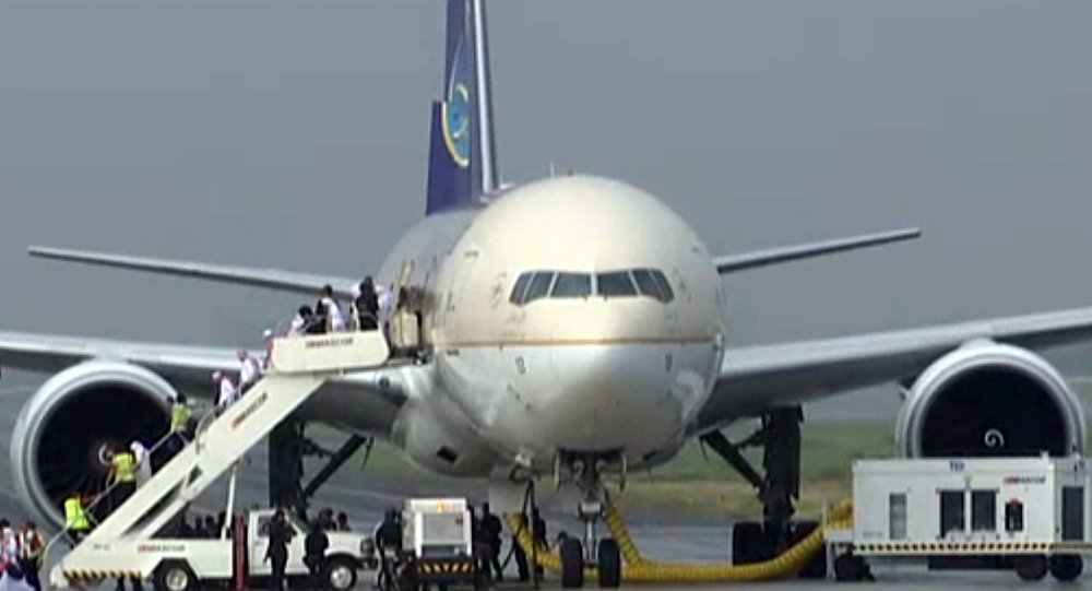In this image made from video, people disembark a Saudi Arabian Airlines plane from Jeddah as it is parked at the airport in Manila, the Philippines, Tuesday, Sept. 20, 2016.
