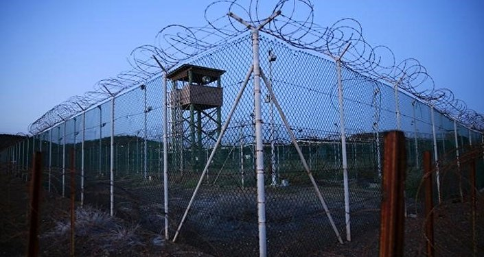 Chain link fence and concertina wire surrounds a deserted guard tower within Joint Task Force Guantanamo's Camp Delta at the US Naval Base in Guantanamo Bay, Cuba.
