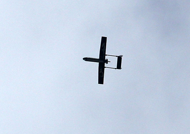 A drone belonging to the Ezzedine al-Qassam Brigades, Hamas' armed wing, flies over Gaza City on December 14, 2014 during a parade by Palestinian militants marking the 27th anniversary of the Islamist movement's creation.