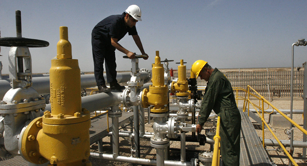 Iranian oil technician, right, and coworker  work at the oil separator facilities in Azadegan oil field, some 480 miles (800 kilometers) southwest of the capital, Tehran, Iran