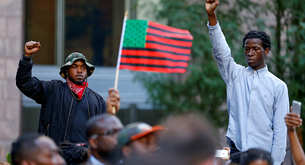 People gather at the intersection of Trade and Tryon Streets in uptown Charlotte, NC to protest the police shooting of Keith Scott, in Charlotte, North Carolina, U.S. September 21, 2016.