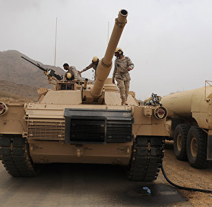 Saudi soldiers are seen on top of their tank deployed at the Saudi-Yemeni border, in Saudi Arabia's southwestern Jizan province, on April 13, 2015