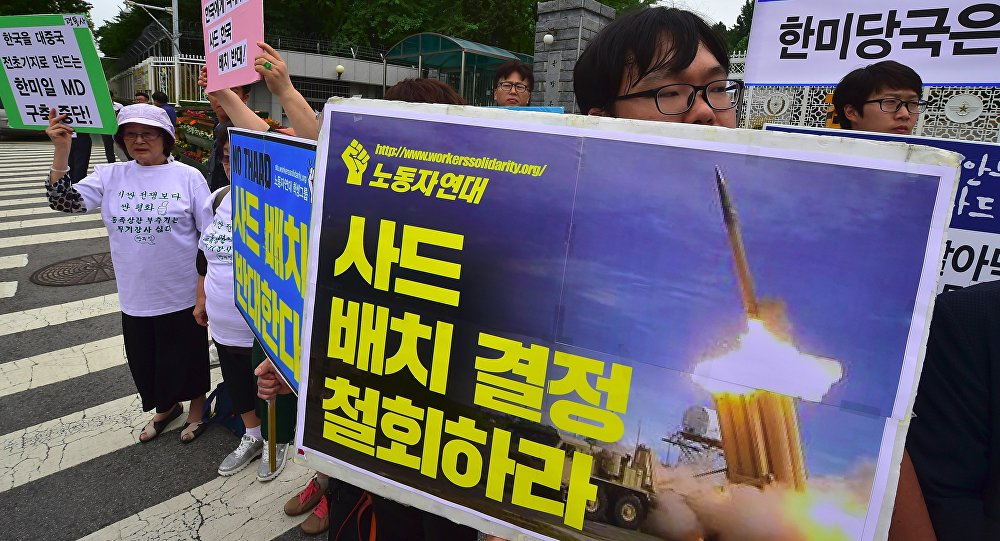 South Korean activists hold placards during a rally against a plan on deployment of the US-built Terminal High Altitude Area Defense (THAAD), outside the Defence Ministry in Seoul on July 13, 2016. Activists have staged a series of rallies voicing their opposition to the missile defense system's deployment in their region.