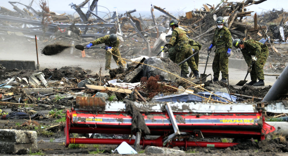 Japan's Self-Defense Force soldiers remove the debris left by the March 11 tsunami in the city of Minamisoma in Fukushima prefecture on May 2, 2011.