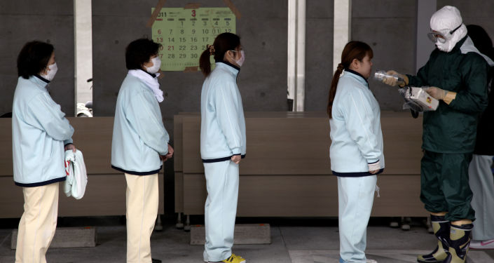 People line up for radiation screening at Koryama in Fukushima prefecture on March 21, 2011.