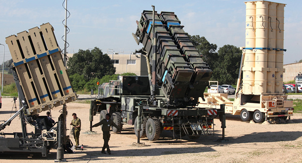 Israeli soldiers walk near an Israeli Irone Dome defence system (L), a surface-to-air missile (SAM) system, the MIM-104 Patriot (C), and an anti-ballistic missile the Arrow 3 (R) during Juniper Cobra's joint exercise press briefing at Hatzor Israeli Air Force Base in central Israel, on February 25, 2016. Juniper Cobra, is held every two years where Israel and the United States train their militaries together to prepare against possible ballistic missile attacks, as well as allowing the armies to learn to better work together.