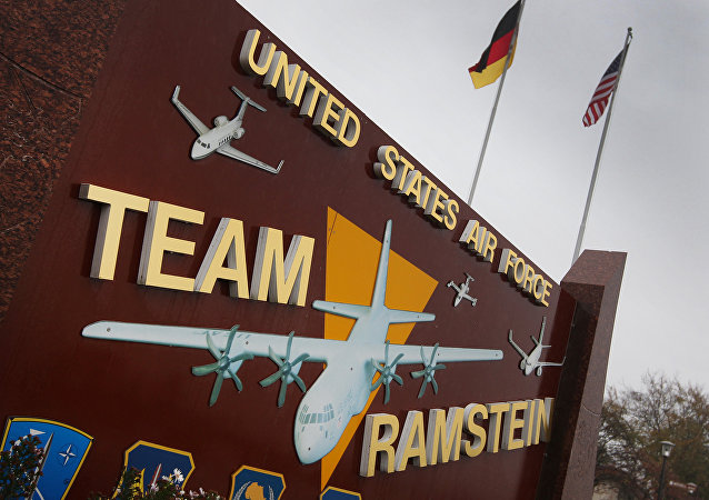 The German and the US flags fly at the entrance to the US Airbase in Ramstein, southern Germany