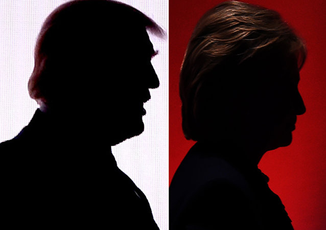 This combination of file photos shows the silhouettes of Republican presidential nominee Donald Trump(R) July 18, 2016 and Democratic presidential nominee Hillary Clinton on February 4, 2016.