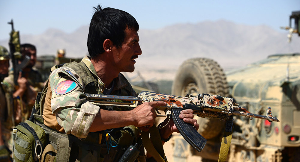 Afghan security personnel take part in a patrol during an operation against Taliban militants in Garmaw Manda in Uruzgan province