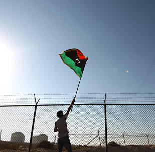 A man waves a Libyan flag