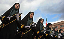 Iranian female police officers wearing chadors parade during a female police graduation ceremony at the Police Academy in Tehran, Iran. (File)