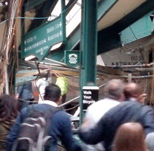 Onlookers view a New Jersey Transit train that derailed and crashed through the station in Hoboken, New Jersey, U.S. in this picture courtesy of Chris Lantero taken September 29, 2016