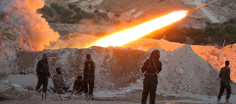 Free Syrian Army fighters launch a Grad rocket from Halfaya town in Hama province (File)